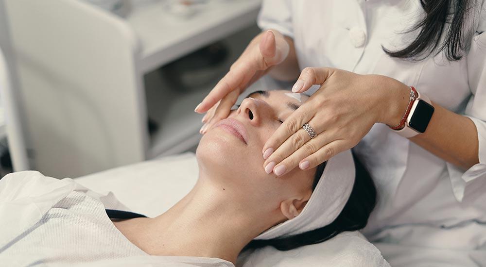 Woman receiving skin treatments in aurora, co